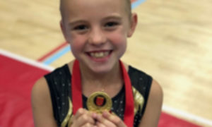 MINNIE MILLER Y5, RECORD BREAKING GYMNAST